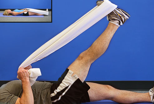 Trainer doing hamstring stretch